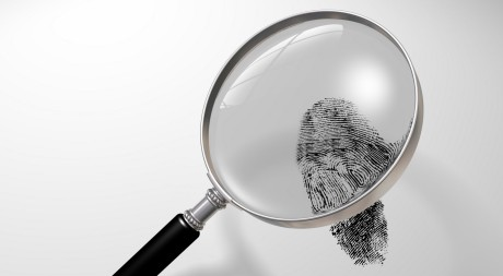 Illustration of a magnifying glass hovering over a fingerprint